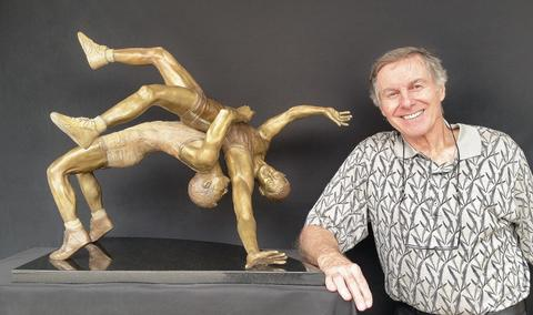 Richard Stravitz with his sculpture.